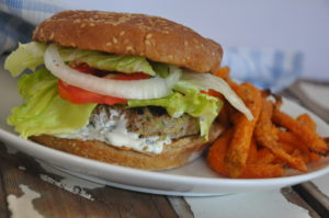 Turkey zucchini burgers with cilantro crema go well with sweet potato fries!